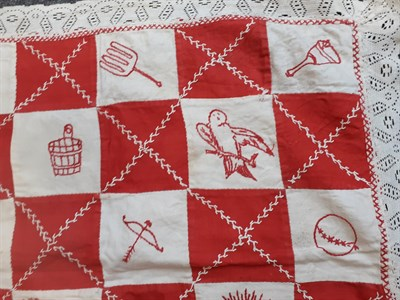 Lot 6038 - Early 20th Century Embroidered Cot Cover, worked in squares of cotton and embroidered in red...