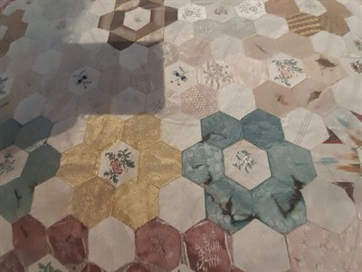 Lot 6046 - A Late 18th Century Silk Patchwork Bed Cover, with a central roundel enclosing a stylised...