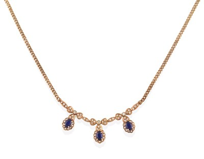 Lot 2002 - A Sapphire and Diamond Necklace, a central panel formed of three ribbon bow drops composed of...