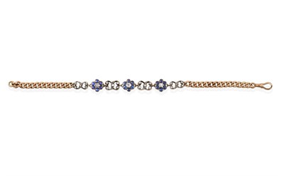 Lot 2005 - An Edwardian Sapphire and Diamond Bracelet, the central section formed of three daisy clusters...