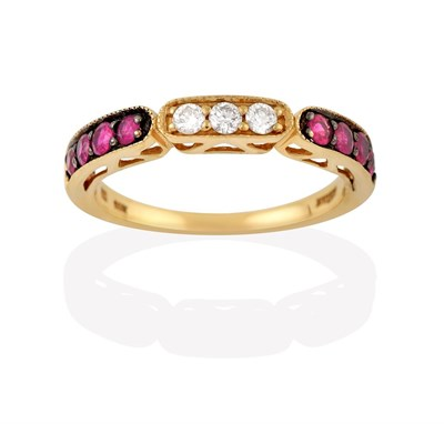 Lot 2010 - A Ruby and Diamond Half Hoop Ring, by LeVian, three round brilliant cut diamonds flanked by...