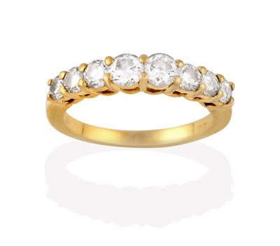 Lot 2014 - A Diamond Eight Stone Ring, the graduated round brilliant cut diamonds, in yellow claw settings, to