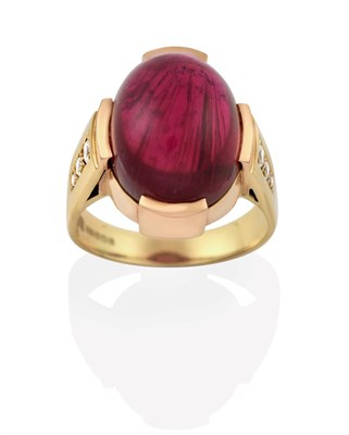 Lot 2017 - An 18 Carat Gold Pink Tourmaline Ring, the oval cabochon pink tourmaline in a yellow claw...