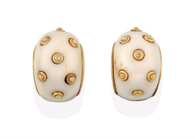 Lot 2018 - A Pair of Shell Designed Earrings, each white stone decorated with yellow bead motifs, length...