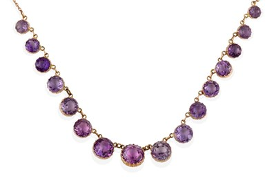 Lot 2022 - An Edwardian Amethyst Necklace, sixteen graduated round cut amethysts in yellow collet settings, to