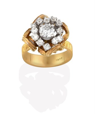 Lot 2023 - A Diamond Cluster Ring, the central round brilliant cut diamond within an undulating border of...