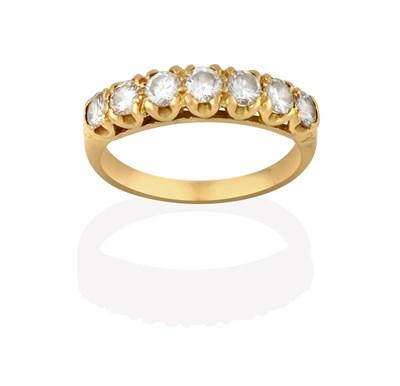 Lot 2024 - A Diamond Seven Stone Ring, the graduated round brilliant cut diamonds in yellow claw settings,...