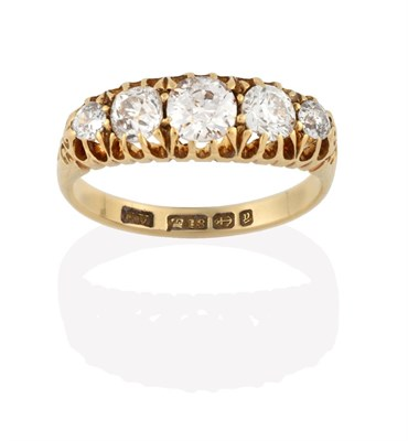 Lot 2026 - An 18 Carat Gold Diamond Five Stone Ring, the graduated old cut diamonds in yellow claw...