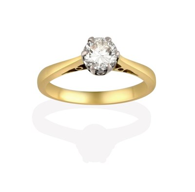 Lot 2028 - A Diamond Solitaire Ring, the round brilliant cut diamond in a white claw setting, to a tapered...