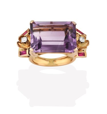 Lot 2031 - An Amethyst Ring, the emerald-cut amethyst in a yellow claw setting, flanked by foliate motifs with