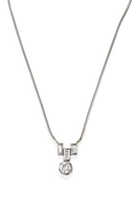 Lot 2033 - An 18 Carat White Gold Diamond Necklace, a trio of baguette cut diamonds suspend a round...