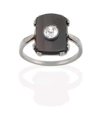 Lot 2037 - An Onyx and Diamond Ring, the oblong onyx plaque in white claw settings, with an old cut...