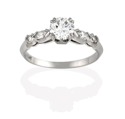 Lot 2038 - A Diamond Solitaire Ring, the round brilliant cut diamond in a white claw setting, to a...