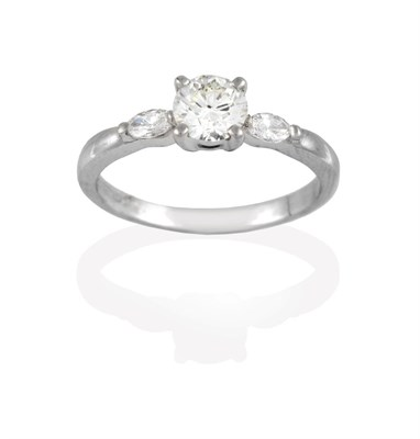 Lot 2039 - A Platinum Diamond Solitaire Ring, the round brilliant cut diamond in a claw setting, to...
