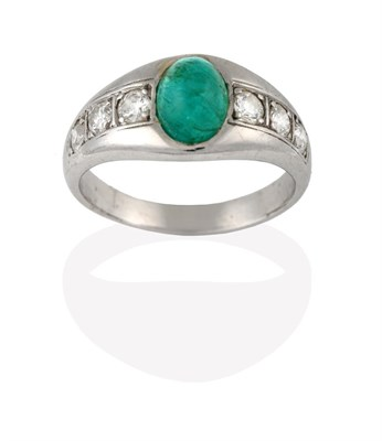Lot 2040 - An Emerald and Diamond Ring, the cabochon emerald in a white collet setting, to shoulders inset...