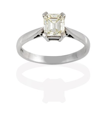 Lot 2041 - An 18 Carat White Gold Diamond Solitaire Ring, the emerald-cut diamond in a four claw setting, to a