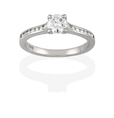 Lot 2042 - A Platinum Diamond Solitaire Ring, the round brilliant cut diamond in a claw setting, to a...