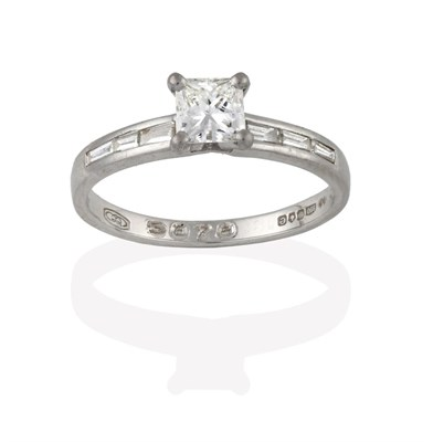 Lot 2044 - A Platinum Diamond Solitaire Ring, the princess cut diamond in a four claw setting, to baguette cut