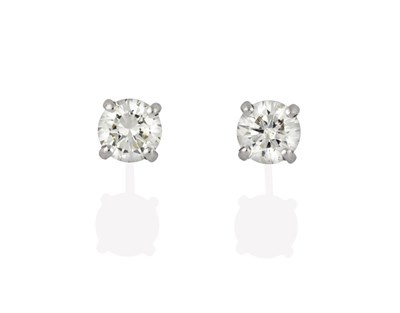 Lot 2047 - A Pair of 18 Carat White Gold Diamond Solitaire Earrings, the round brilliant cut diamonds in...