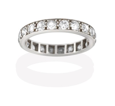 Lot 2048 - A Diamond Eternity Ring, the twenty old cut diamonds in white claw and channel settings, total...