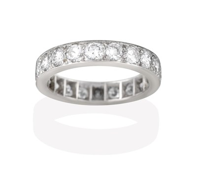 Lot 2049 - A Diamond Eternity Ring, the twenty round brilliant cut diamonds in white claw and channel...