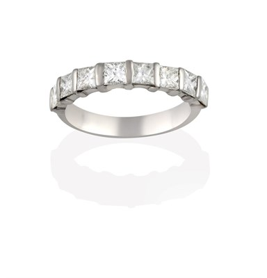 Lot 2050 - A Diamond Half Hoop Eternity Ring, the princess cut diamonds spaced by white bars, to a plain...