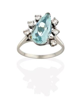 Lot 2051 - An Aquamarine and Diamond Ring, the pear cut aquamarine flanked by trios of round brilliant cut...
