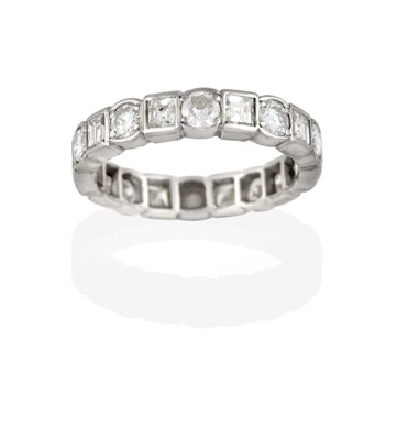 Lot 2052 - A Diamond Eternity Ring, the continuous band formed of round brilliant cut diamonds alternating...