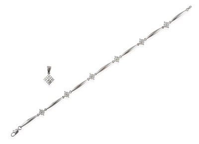 Lot 2053 - A Diamond Bracelet, formed of six round brilliant cut diamond clusters in white claw settings,...