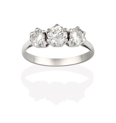 Lot 2054 - A Diamond Three Stone Ring, the round brilliant cut diamonds in white claw settings, to a...
