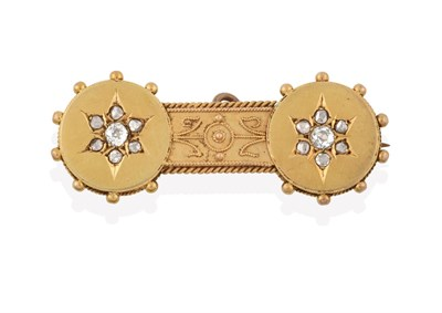 Lot 2062 - A Victorian Diamond Bar Brooch, two yellow circular plaques each with a star motif set with old cut