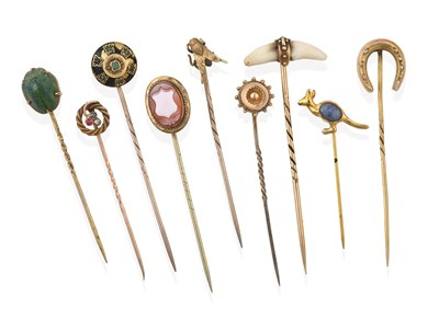 Lot 2064 - A Collection of Nine Stickpins, comprising of a cornelian cameo shield example; a scarab...