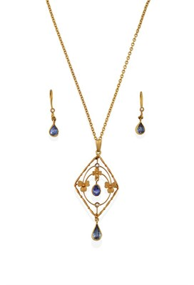 Lot 2065 - An Edwardian Sapphire and Seed Pearl Pendant on Chain, of openwork foliate lozenge design, with...