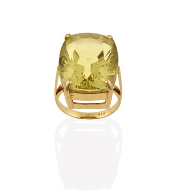 Lot 2070 - A Citrine Ring, the fancy oval cut citrine in a yellow four claw setting, to a tapered shoulder...