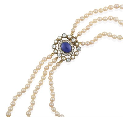 Lot 2072 - A Three Row Cultured Pearl Necklace, the 79:85:88 cultured pearls knotted to an oval clasp...