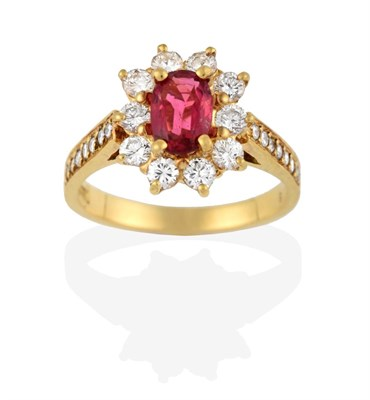 Lot 2074 - A Pink Tourmaline and Diamond Cluster Ring, the oval cut pink tourmaline within a border of...