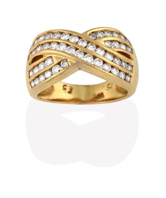 Lot 2077 - A Diamond Ring, two double row crossover bands inset with eight-cut diamonds, in yellow channel...