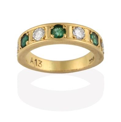 Lot 2079 - An Emerald and Diamond Half Hoop Ring, four round brilliant cut diamonds alternate with three round