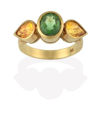 Lot 2080 - A Green Tourmaline and Yellow Sapphire Three Stone Ring, the central oval cut green tourmaline...