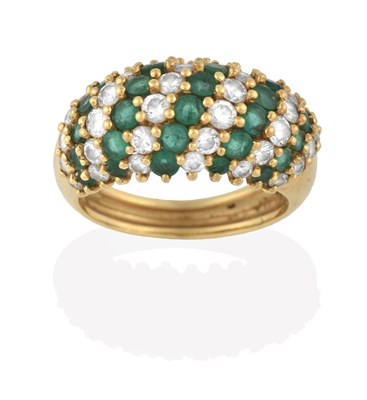 Lot 2081 - An Emerald and Diamond Ring, formed of eleven alternate rows of round brilliant cut diamonds...
