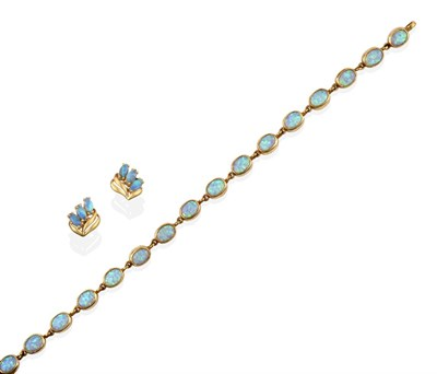 Lot 2082 - An Opal Bracelet, the sixteen chain linked oval cabochon opals in yellow rubbed over settings,...