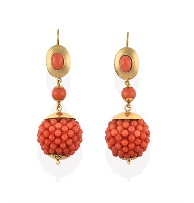 Lot 2083 - A Pair of Coral Drop Earrings, the oval cabochon coral in a yellow rubbed over setting within a...