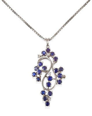 Lot 2085 - A Sapphire and Diamond Pendant on Chain, the abstract swirl motif pendant set throughout with...