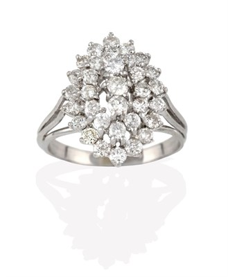 Lot 2086 - A Diamond Cluster Ring, three round brilliant cut diamonds within a double stepped border of...