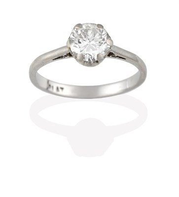 Lot 2088 - A Diamond Solitaire Ring, the old cut diamond in a white claw setting, to a tapered shoulder...