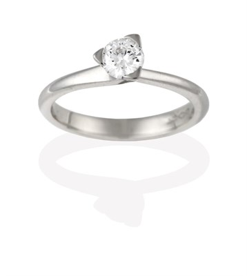 Lot 2090 - A Platinum Diamond Solitaire Ring, the round brilliant cut diamond in a claw setting, to...