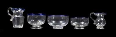 Lot 3 - A Glass Cream Jug and Sugar Bowl, circa 1800, of fluted form with blue glass rims, jug 11cm...