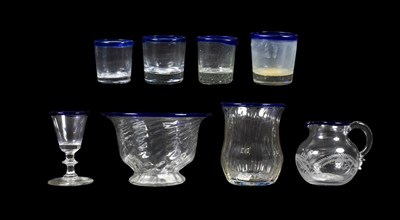 Lot 4 - A Glass Sugar Bowl, circa 1800, of wrythen fluted ogee form with blue glass rim, 8.5cm high; A...