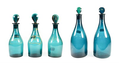 Lot 11 - A Matched Set of Three Green Glass Spirit Decanters and Stoppers, early 19th century, of mallet...