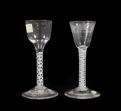 Lot 14 - A Wine Glass, circa 1750, the rounded funnel bowl engraved with fruiting vine on an opaque...